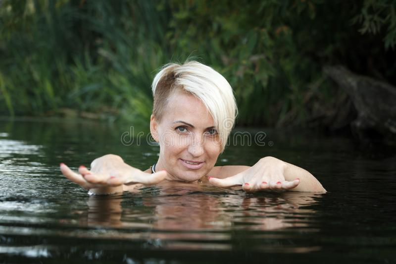 Sexy naked by the river