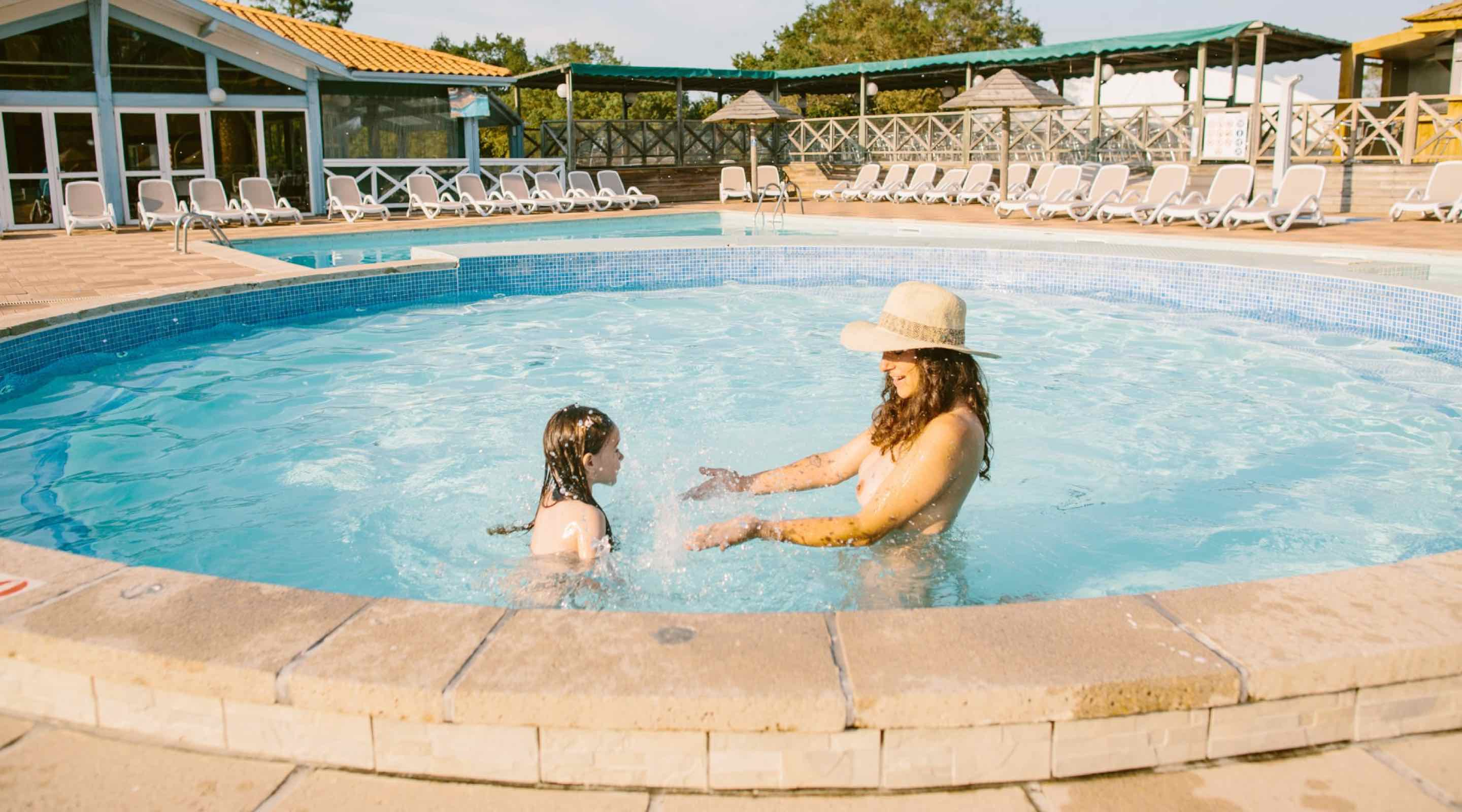 Nudist family at the pool